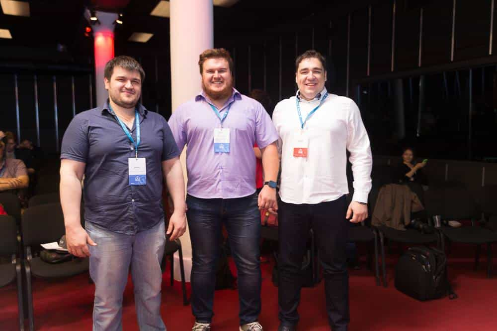 Three big cheery guys at WordCamp